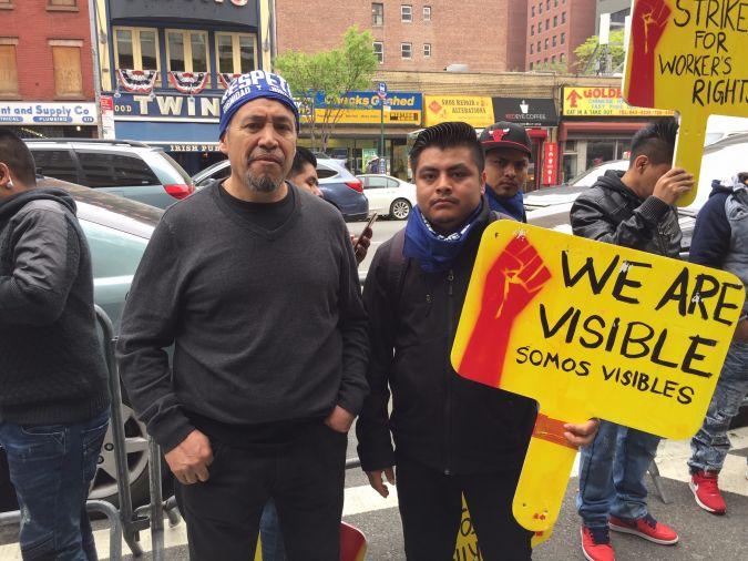 B & H warehouse workers Armando Girron, left, and Santiago Ibarra.