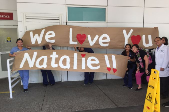 Grumet's coworkers welcoming her home.