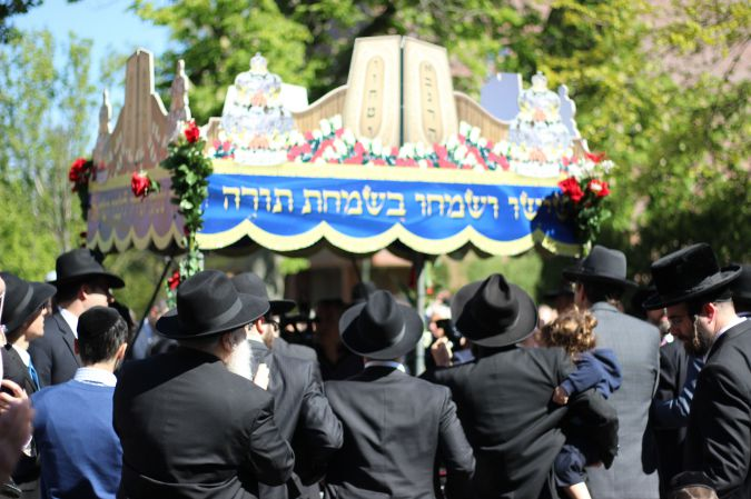 Holy Business: A crowd in Kew Gardens gathers for a Torah dedication ceremony underneath a canopy.