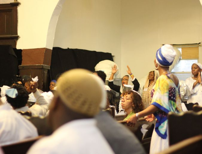 Voices in Praise: Congregants gathered at Bnai Adath Kol Beth Yisrael, an Israelite synagouge in Brooklyn, sing during the inauguration ceremony of Rabbi Funnye.