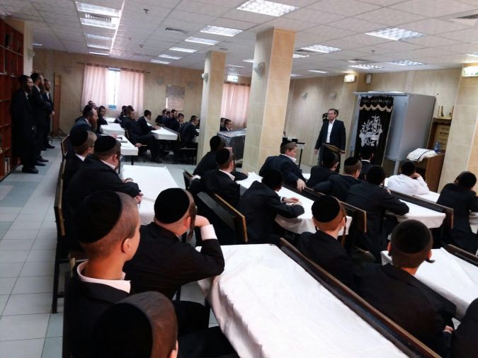 Menachem Bombach teaches students in his Midrasha Hahasidit in Beitar Ilit.
