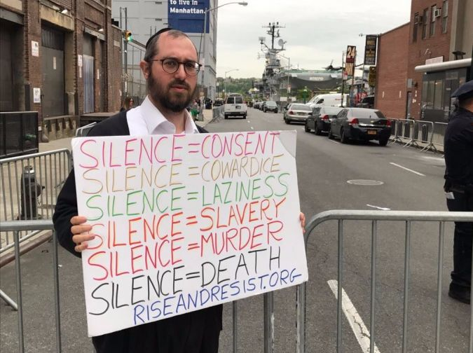 Shaya Bodansky protesting a President Trump appearance at the Intrepid in New York.