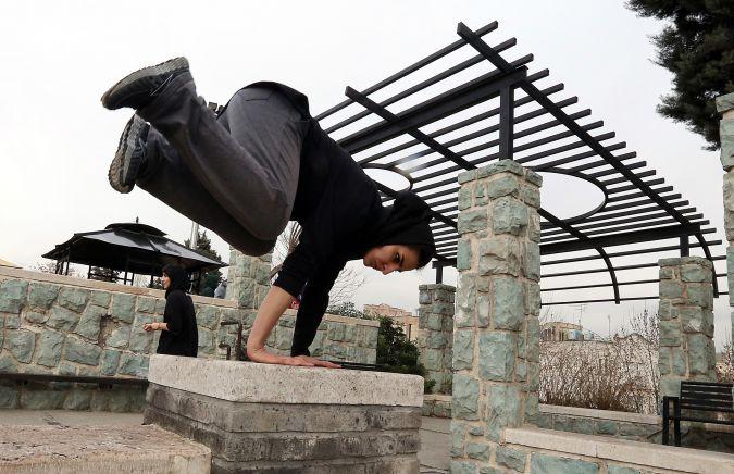 Iranian women practice parkour in Tehran's Tavalod Park.