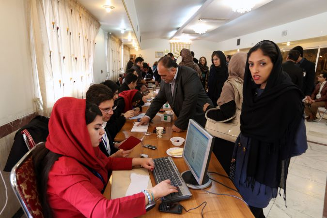 Jewish Iranians cast their vote at a synagogue used as a polling station for the Jewish community in Tehran on February 26, 2016. Iranians began voting across the country in elections billed by the moderate president as vital to curbing conservative dominance in parliament and speeding up domestic reforms after a nuclear deal with world powers.