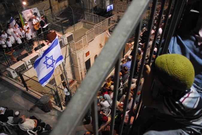 Jewish settlers celebrate establishment of a permanent Jewish presence in East Jerusalem.