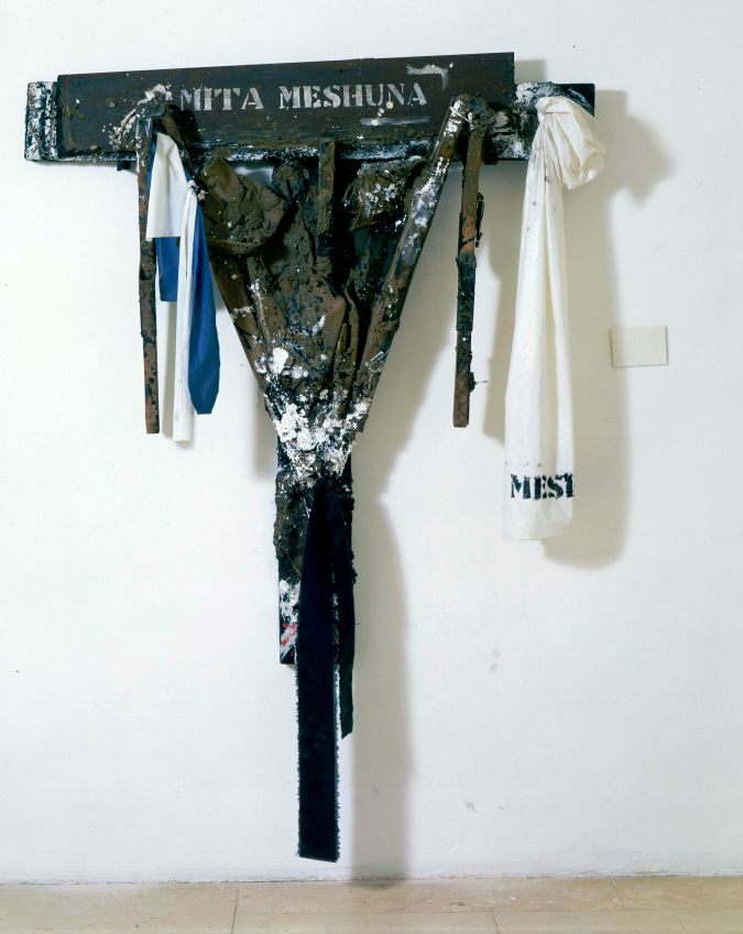 "Igael Tumarkin's 1984 sculpture ""Mita Meshuna,"" a crucifix made out of an army bed, is a comment on the human toll of the First Lebanon war. The title is a play on words meaning both ""Strange Death"" and ""Strange Bed."""