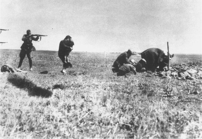 Executions of Jews by German army mobile killing units (Einsatzgruppen) near Ivangorod, Ukraine.