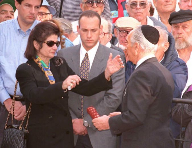 Yitzak Rabin's widow, Leah, greets Shimon Peres after her husband's assassination in 1995.