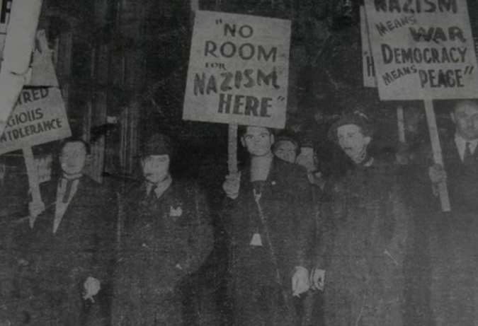 The Minutemen, a Jewish anti-Fascist group active in the 1930's. The author's cousin, Jake Rothseid, stands on the far left, holding a picket sign and a cigar.