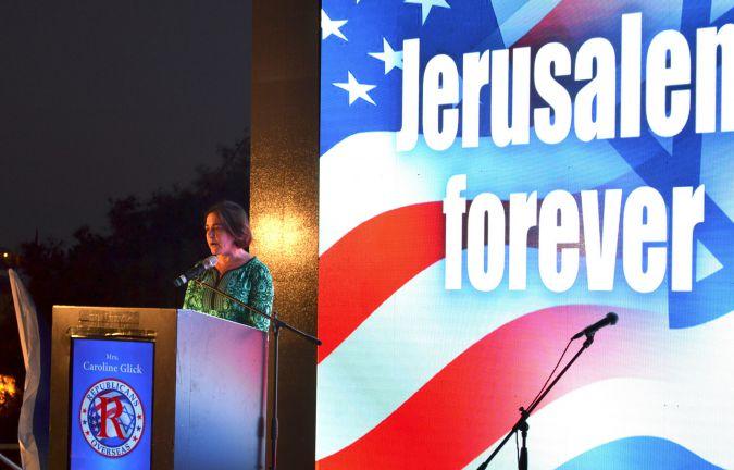 Right wing columnist Caroline Glick speaking at the Trump rally in Jerusalem.