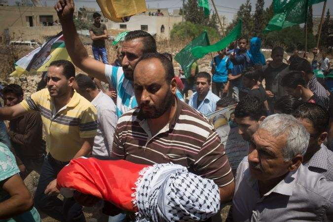 Palestinians mourn 18-year-old baby killed by suspected Jewish extremists.