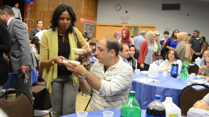 Participants at a Jewish-Muslim iftar dinner at the Kings Bay Y.