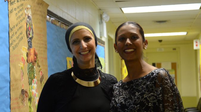 Nervin Bekhit (left), who is Muslim, with her friend Sarah Miller, who is Jewish, attend a Muslim-Jewish iftar dinner at the Kings Bay Y.