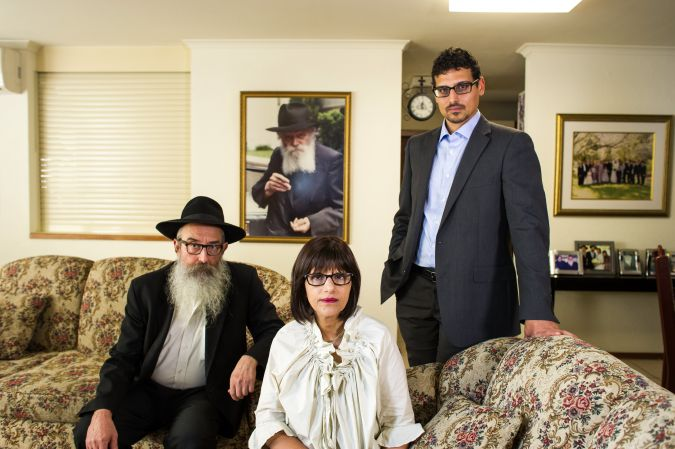 ** From right, Manny Waks stands with his parents, Chaya and Zephaniah, in their former home in Melbourne.