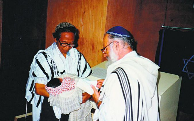 The Pioneer: Rabbi Eliyahu Avichail (right), performs a ritual circumcision ceremony for a child in Italy who family identifies as Morranos.