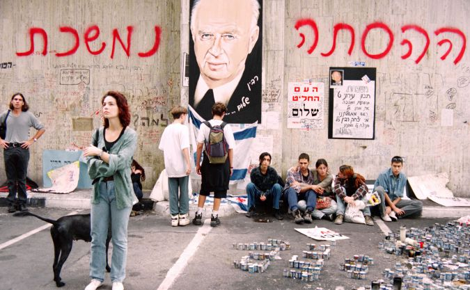 Mourners gather at memorial for Yitzhak Rabin after his assassination by a right-wing extremist.