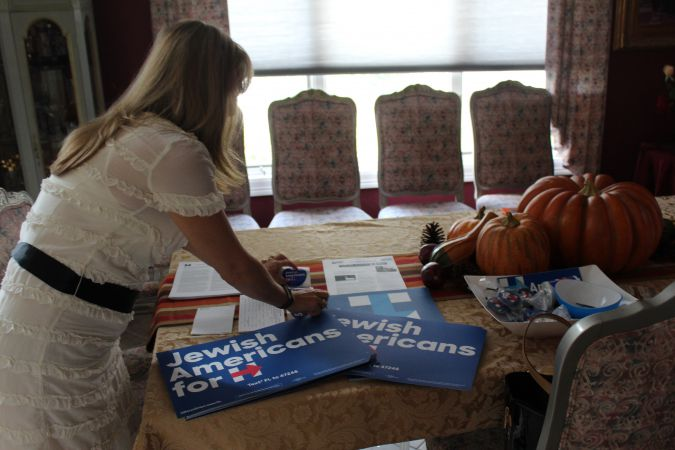 Rachelle Litt, a Florida Jewish Democratic activist, arranging pro-Clinton material at her home in Palm Beach Gardens, Florida