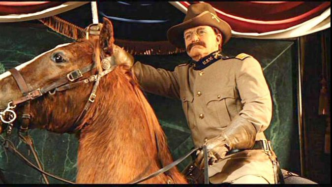"Robin Williams as Theodore Roosevelt, with his horse, Little Texas, in ""Night at The Museum."""