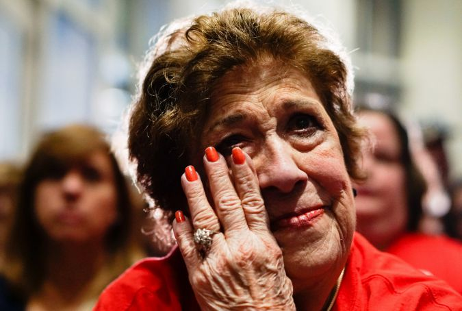 Supporter of Marco Rubio watches as he announces he's suspending his campaign.