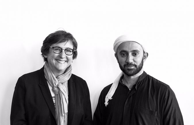"""""""We have to act as if we really believe 'never again' really means 'never again,"""""""" said Rabbi Sharon Kleinbaum (left) of Congregation Beit Simchat Torah.  She stands with Imam Khalid Latif (right) of the Islamic Center at NYU."""