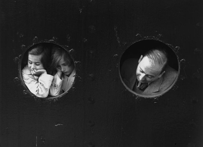 Looking Back: German Jewish refugees, looking through portholes aboard the St Louis on arrival at Antwerp, where a temporary home was found for the 900 refugees aboard. Most were later deported.