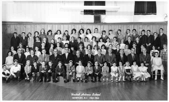 Vibrant:  Newport's United Hebrew School poses for its 1963-'64 portrait. Rabbi Theodore Lewis, a towering presence for almost four decades, is seated fifth from left in the second row from the front.