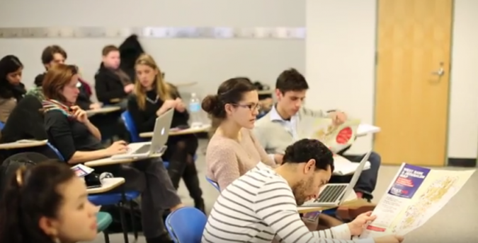 Students study maps in a 2013 Queens College course about the Middle East.