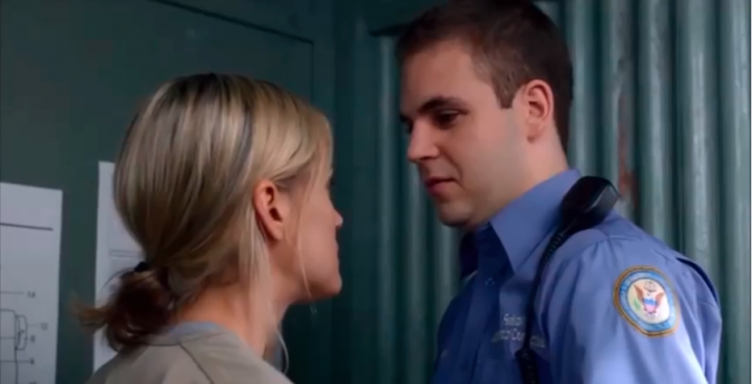 """Alan Aisenberg in a scene with Taylor Schilling on """"Orange is the New Black."""""""