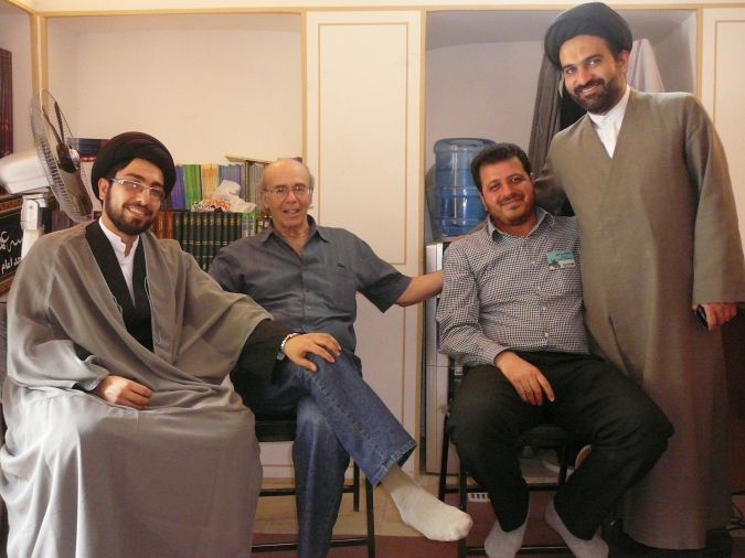 People-to-People: Iran tour operator Steve Kutay of Asheville, North Carolina, (second from left) and an Iranian tour guide meet with two Iranian clerics at the Grand Mosque in Isfahan in spring 2014.