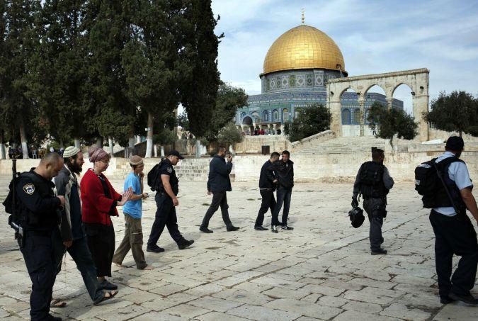 Israeli police escort Jewish visitors to the Temple Mount in Jerusalem.