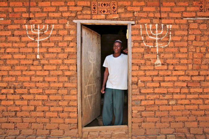 Abayudaya Jew Joseph Mwanika in the doorway of a house, Nalubembe Village, Kikubu District, Uganda. August 2013.