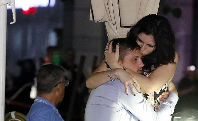 Stunned victims comfort each other after Tel Aviv terror attack.