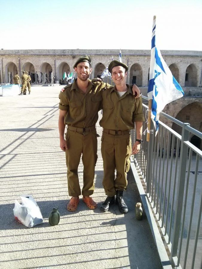 At Ease: Gordon, right, with fellow lone soldier Yonah Hochhauser in 2013.