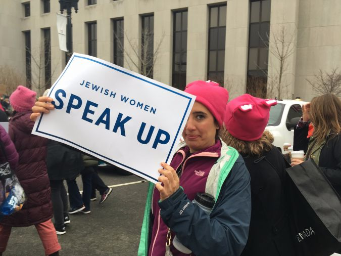 """This protester in Washington, D.C. wears the de rigeur pink """"pussy"""" hat."""