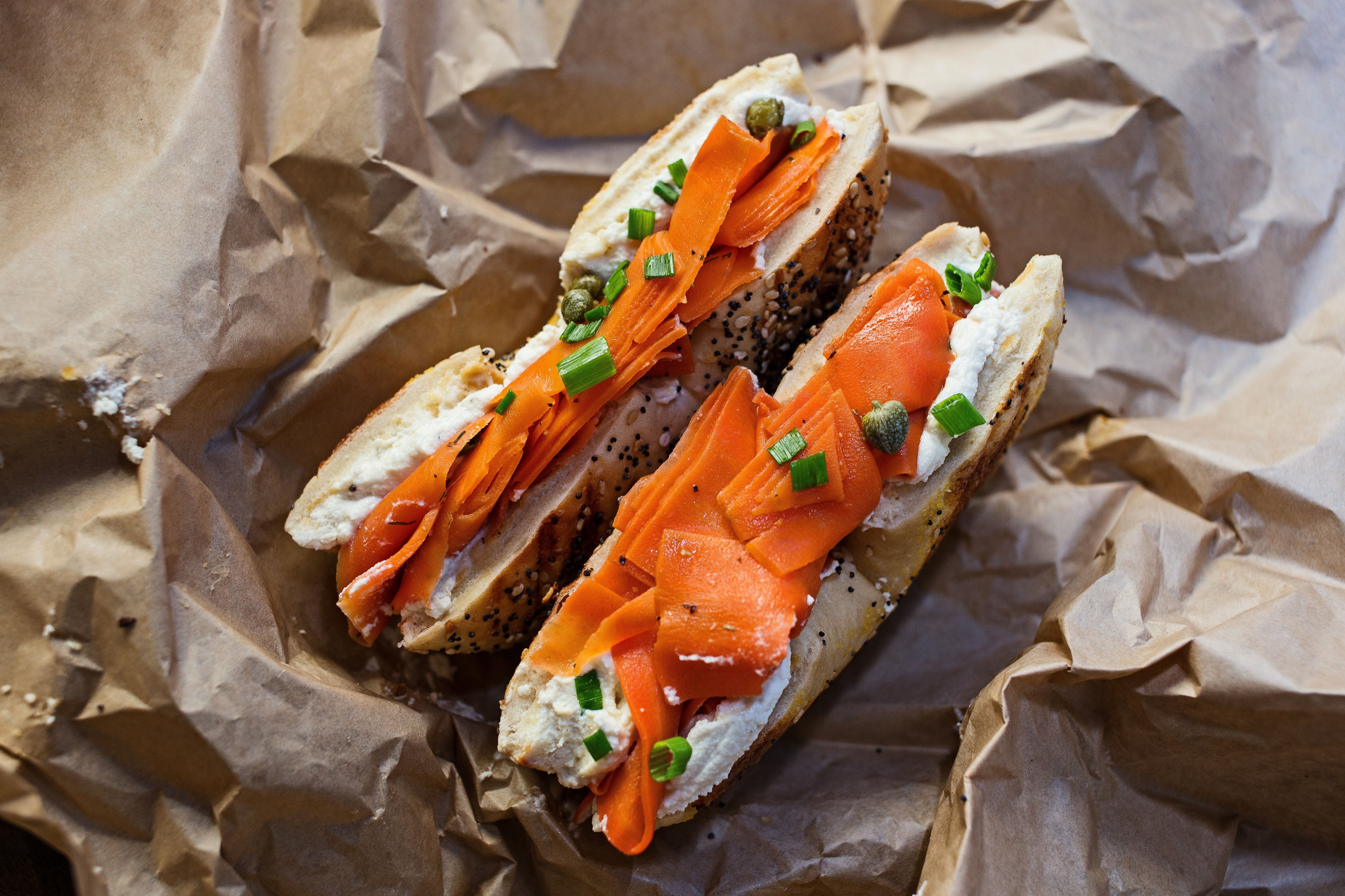 The Edith: A Baz Bagels bagel is topped with house-made cashew cream cheese, carrot lox, capers and chives.