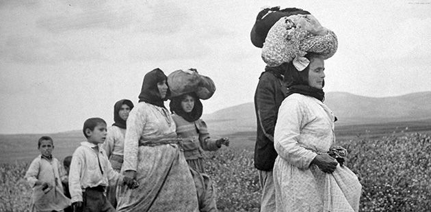 Genocide?: Palestinians evacuate the village of Zenin in 1948. Some scholars say that what is now called ?ethnic cleansing? constitutes a form of genocide.