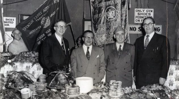 Holiday Feast: Purim celebration at Fort Dix, New Jersey, organized by the Trade Union Council and the Jewish War Veterans Organization, who supplied the food for the festivities attended by Jewish veterans and active service men and women.