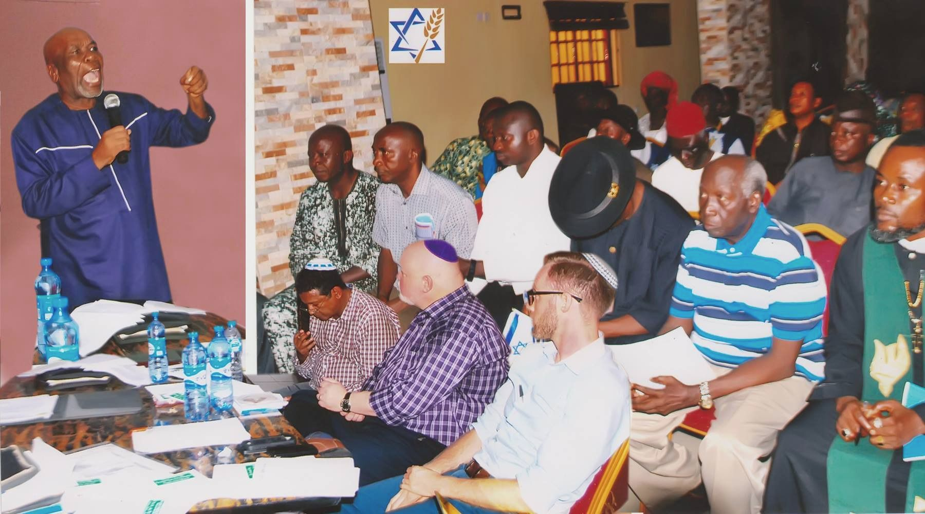 Onwukwe Alaezi, standing, presents to a group of Igbo and visitors from Jewish Voice Ministries. Alaezi is part of an organization of Nigerian academics who promote the Israelite origin story of the Igbo.