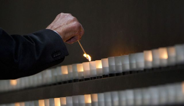 A candle being lit in the Hall of Remembrance at the Holocaust Memorial Museum in Washington.