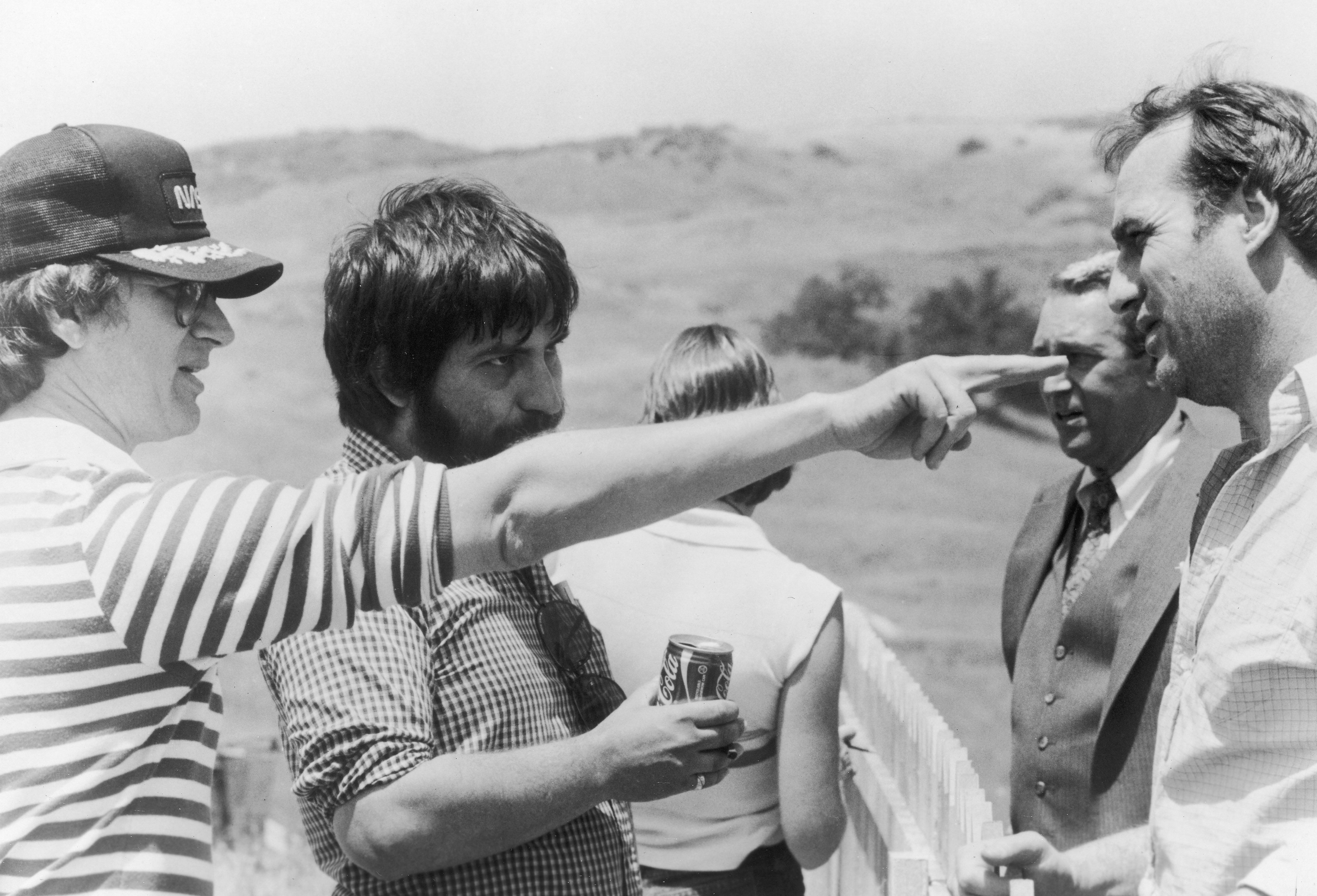 Horror Hits Home: Producer and uncredited director Steven Spielberg (far left) on the set of 'Poltergeist' with director Tobe Hooper, actors James Karen and Craig T. Nelson in 1982.