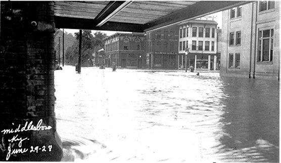 Floodwaters inundate downtown Middlesboro in 1928, ruining Louis Stern's general store.