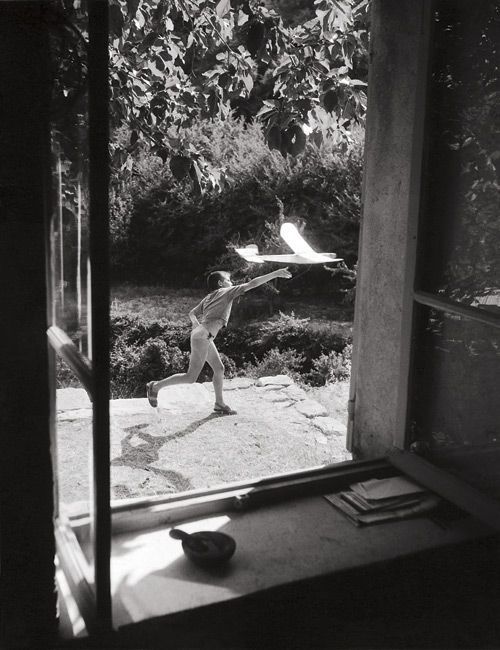 Paper Planes: The photographer catches this launch through a window. (Photo by Willy Ronis)
