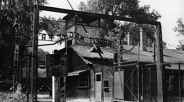 Back in Time: A 1955 view of the entrance gates to the barracks of Auschwitz.