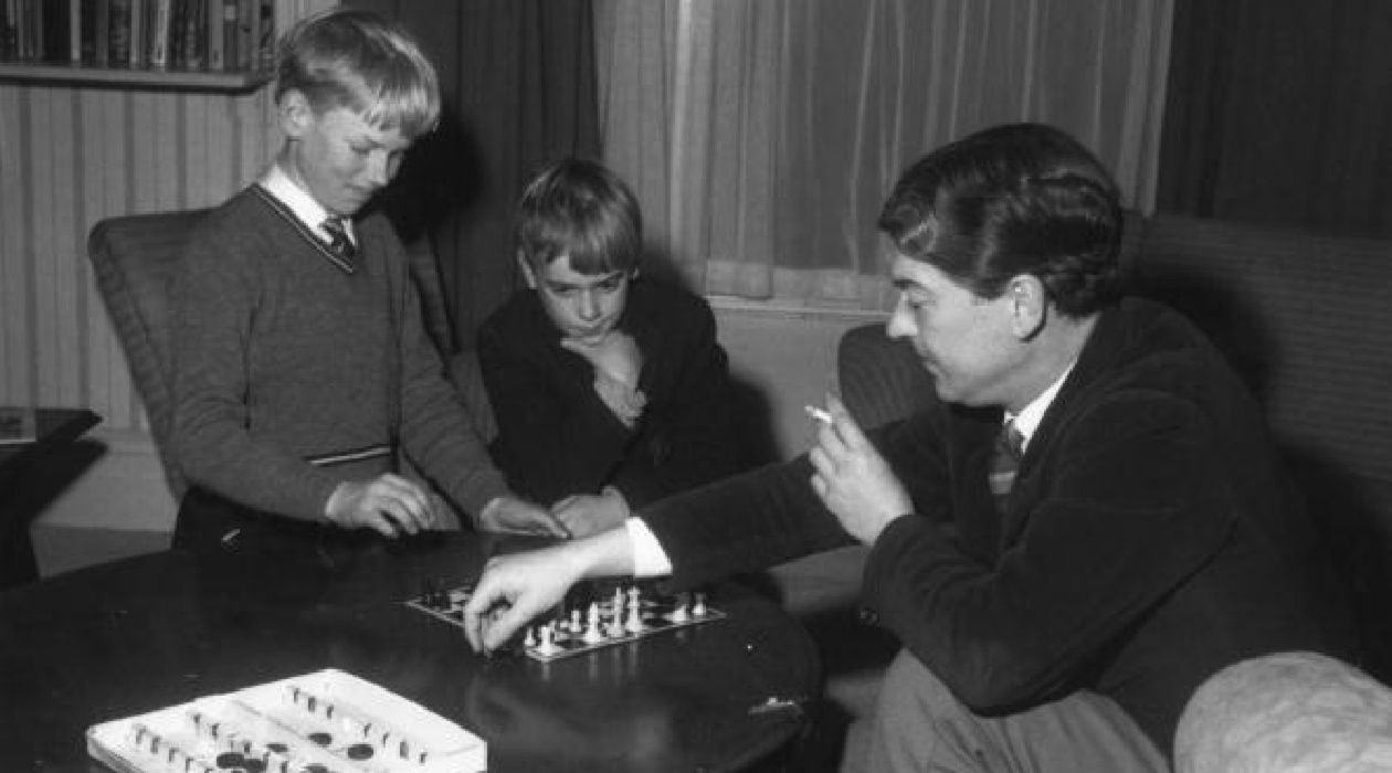 Games Authors Play: Author Kingsley Amis plays chess with his sons Martin and Philip.