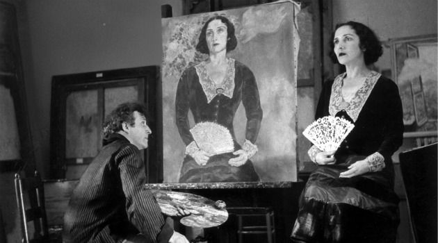 Green in Black and White: Marc Chagall is seen here in his studio working on his painting ?Bella in Green,? which was completed in 1935.