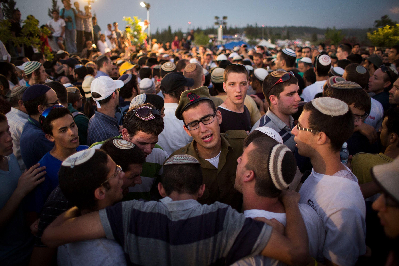Crowds gather to mourn at funeral of Eyal Yifrah, 19, Gilad Shaar, 16, and Naftali Fraenkel, 16.