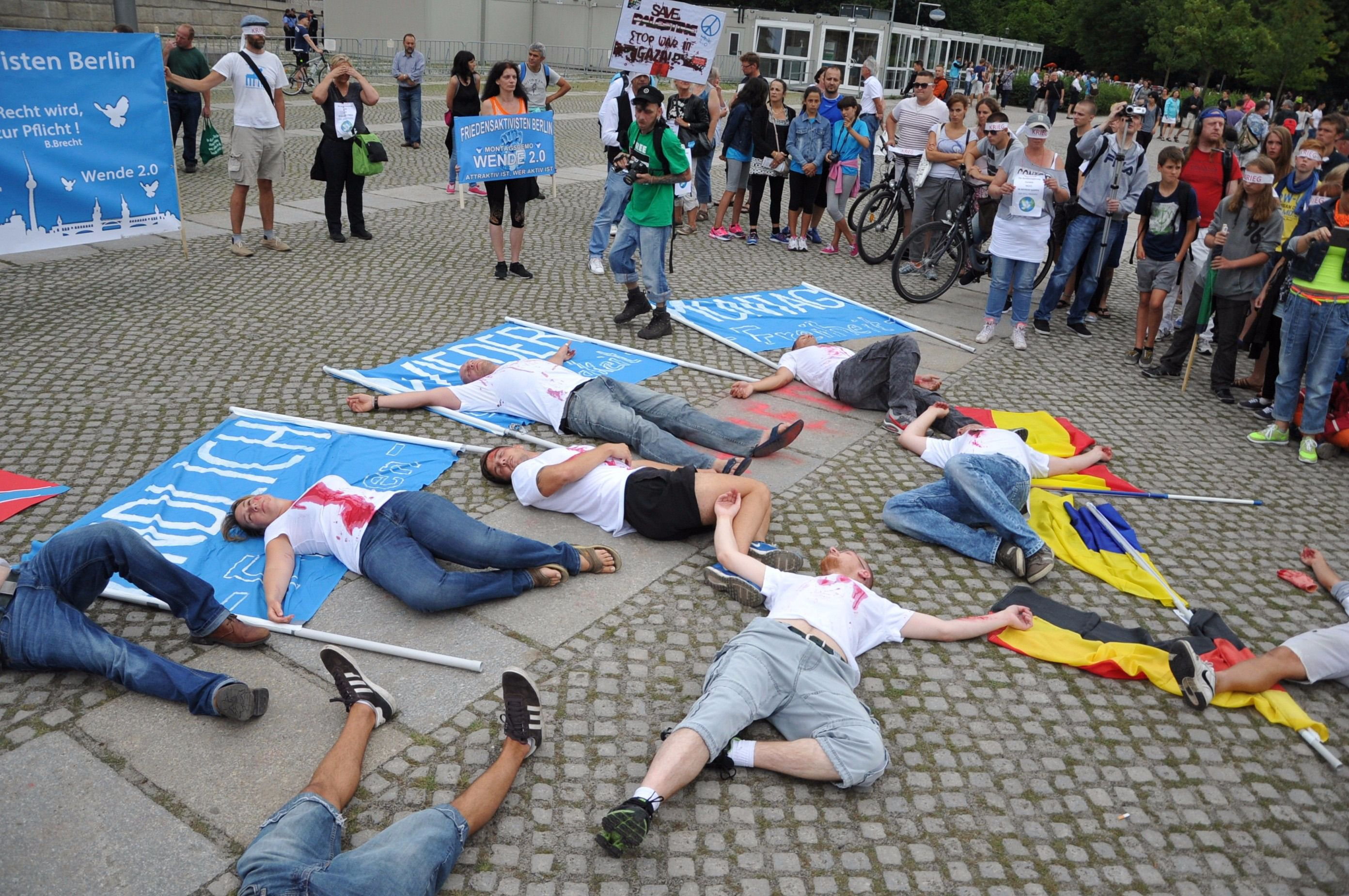 Not Silent: Protestors lie prostrate in front of the Bundestag last summer to symbolize Palestinian civilians killed during Israel's 2014 military offensive in Gaza.
