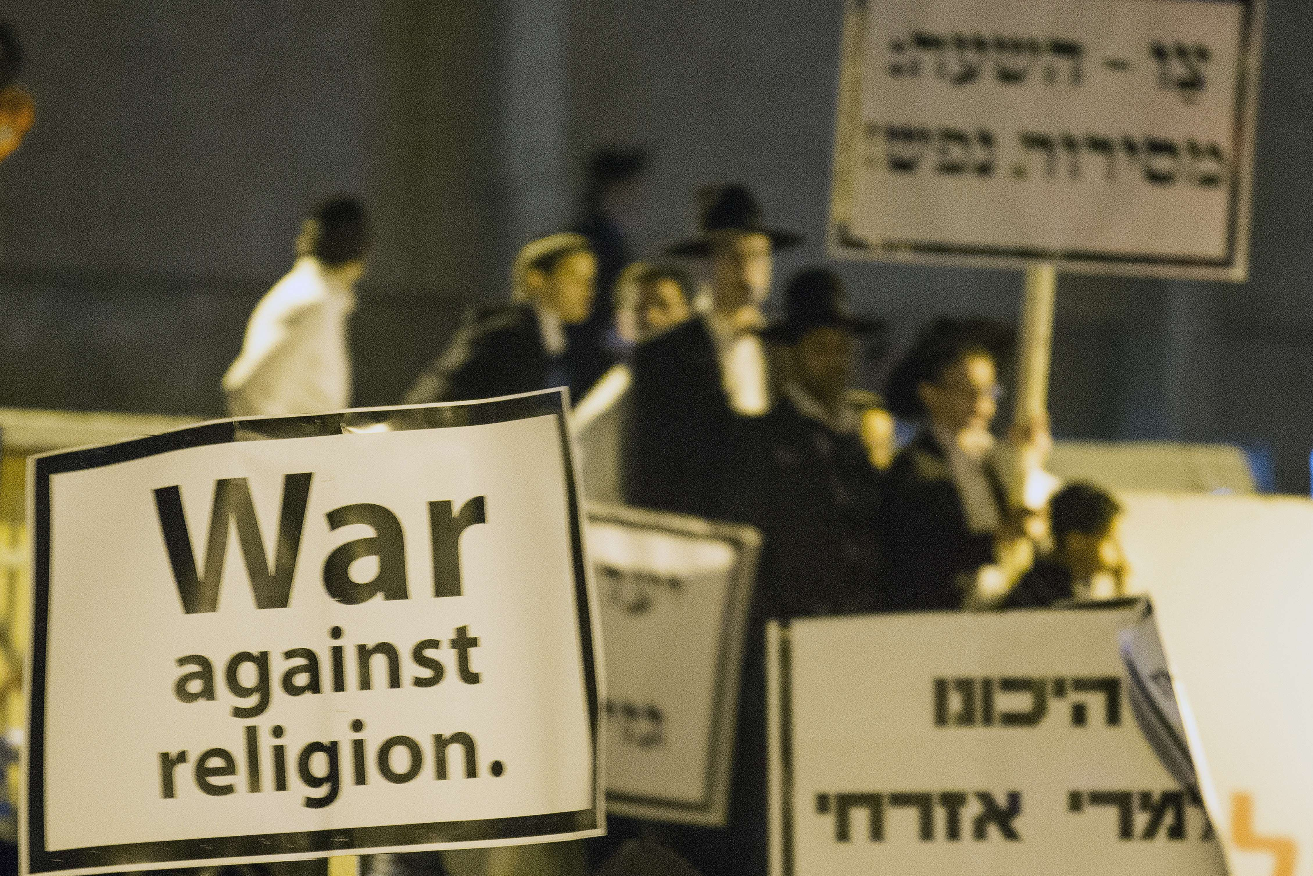 Ultra-Orthodox Jews gather in Bnei Brak to protest Haredi draft laws in Israel in March 2014.