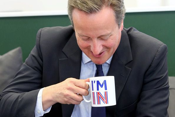 Britain's Prime Minister David Cameron sips from an 'I'm In' mug as he meets television presenters Jeremy Clarkson and James May during a visit to W Chump & Sons Ltd TV studio in west London.