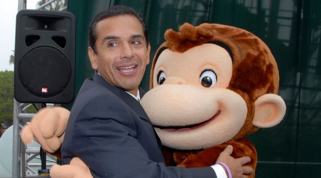 Curiouser and Curiouser: Back in 2007, Los Angeles mayor Antonio Villaraigosa posed with Curious George, a creation of Margret and H.A. Rey, whose story is being told at the Holocaust Museum Houston.
